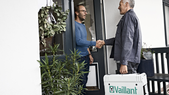 Customer Service: Customer and installer shake hands at the front door