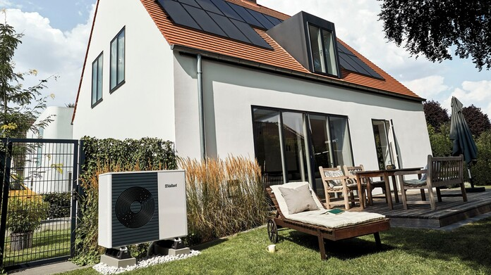 Modernised house with a heat pump in the garden